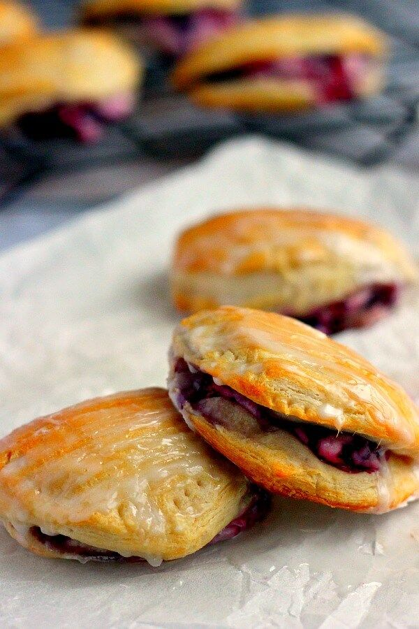 Light, fluffy, and bursting with a creamy fruit center, these Berry Cream Cheese Turnovers are perfect for breakfast, a mid-morning snack, or dessert!