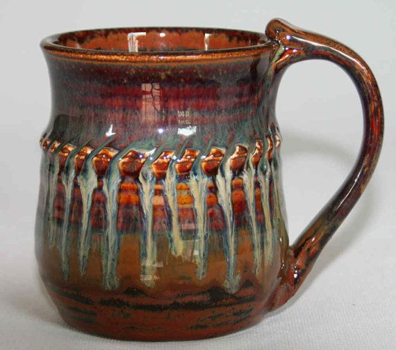 This handmade pottery mug was thrown on a pottery wheel with some ridges formed into the sides of the mug and decorated with texture. The mug is in