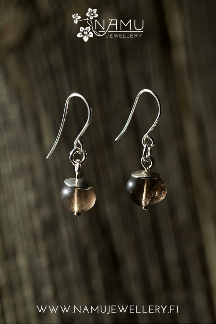Silo One Earrings. Made of recycled silver and ethically sourced smokey quartz. The stones in Silo are tumbled to remind pebbles at a beach.