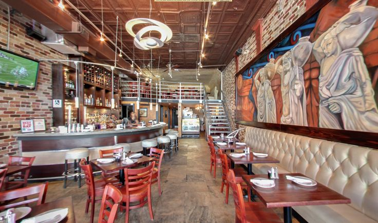 The Acropolis located in Tampa Ybor city. Has A great atmosphere blending Great tasting Greek food with music and beautiful belly dancers.