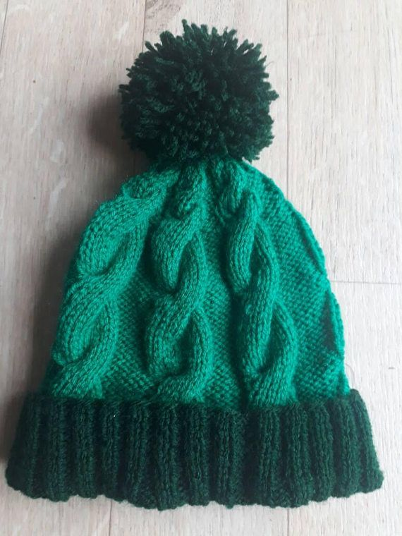 Check out this item in my Etsy shop https://www.etsy.com/uk/listing/546379873/hand-knitted-childs-pom-pom-hat