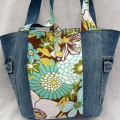 Vintage sheets would work and repurposed jean pockets on the sides. Reminds me of a perfect beach bag!