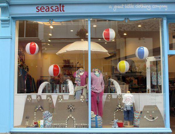 Seaside Themed Window Display With Beach Balls And Sand