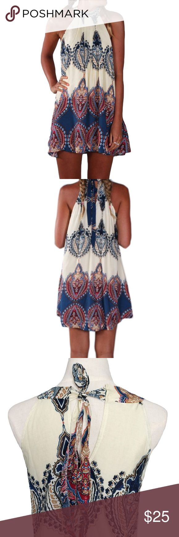 Boho Dress - Bohemian -Sleeveless Halter Flowy Boho Dress - Bohemian -Sleeveless Floral Print Flowy - Bohemian Babe Halter Neck - Sleeveless  Perfect dress to wear as a casual summer dress during the day or evening with sexy shoes and accessories.                                                Available in Small, Medium, or Large Size:S Bust:84cm Length:80cm   Size:M Bust:88cm Length:81cm  Size:L Bust:92cm Length:82cm  Off white, navy blue, purple make a beautiful Aztec/Bohemian pattern…
