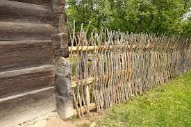 stick fence....How long would this last at the Hendrix Homestead...I like it...