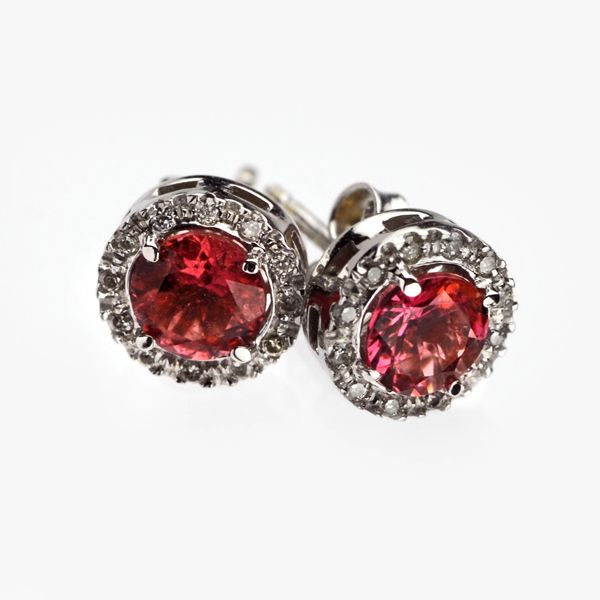 Stunning 9K white gold stud earrings, with pink tourmaline, surrounded by diamonds