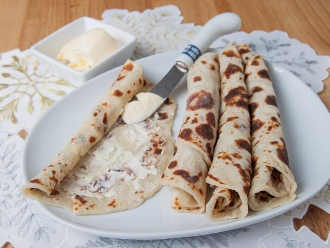 A recipe for Lefse (Easy Instant Mashed Potato Version) made with butter, salt, water, instant mashed potatoes, milk