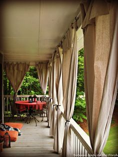 Make Drop Cloth Curtains for Outdoor Spaces and Porches.  Rather than cutting excess and hemming that side, this crafter folded the excess over as a valance.   kh