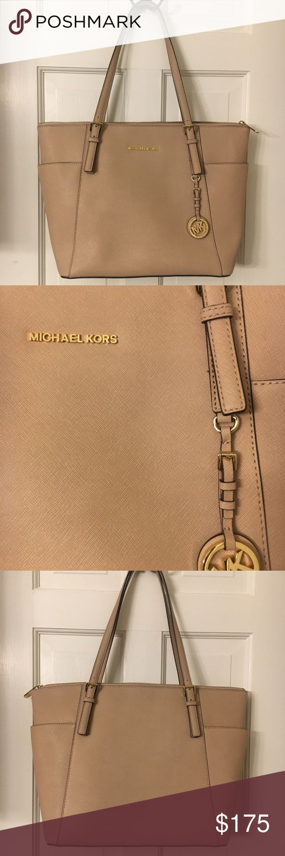 NWOT Michael Kors Jet Set Tote Never Carried East West Jet Set Tote in Smooth Saffiano Leather. The Color is called Blush. Stunning tote with Gold tone hardware and zip top closure. Lines with MK Signature lining, has key fab, zip side pocket, 2 cell pockets and a slip pocket. Exterior has 2 side pockets. MK booklet still in purse. Bought it for my daughter who didn't line it. Smoke free home Michael Kors Bags Totes