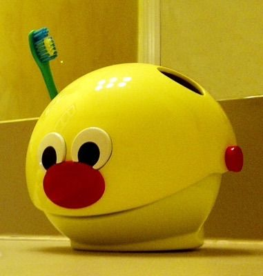 BrushyBall -The only toothbrush holder in the world that coaches kids through complete brushing each time they brush.