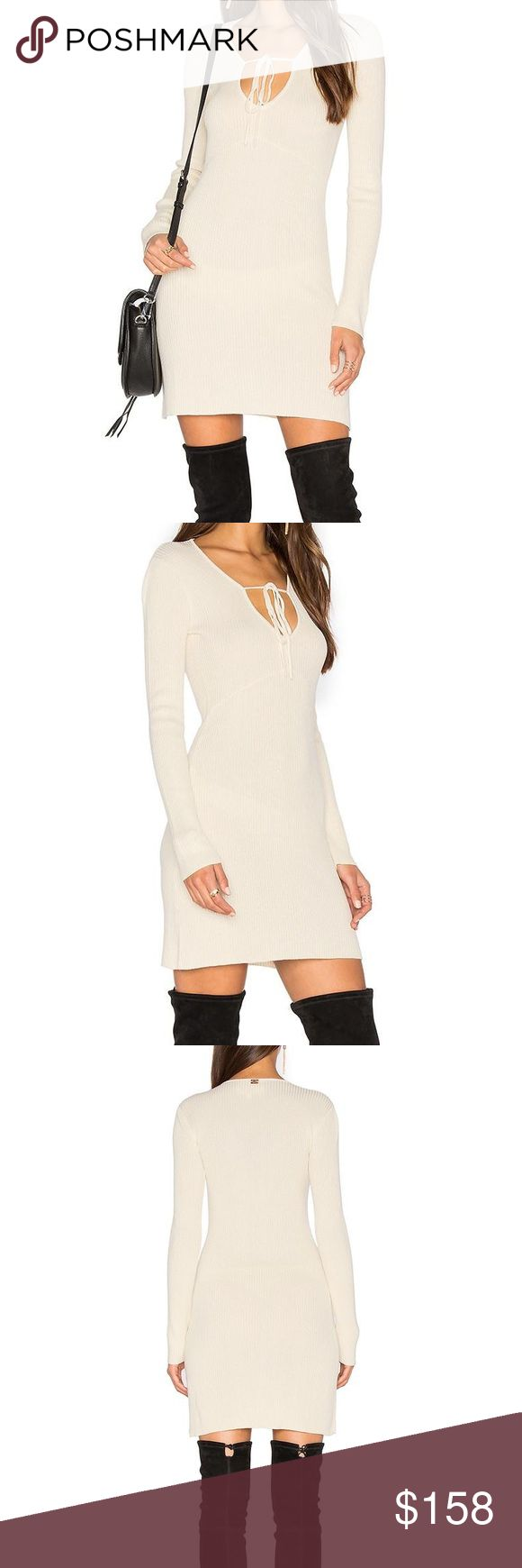 NWT For Love & Lemons KNITZ Delancey Mini Dress The Delancey Mini Dress from For Love & Lemons KNITZ Collection is here to make sure you arrive 5 minutes early. This sweet and soft number features mini rib stitching, an empire waist seam and a plunging neckline to keep your outfit needs cozy all day! So, roll up your sleeves and get the job done in this falls must have knit dress.  Details 10% silk, 20% cotton, 70% lyocell Mini rib stitching Dry clean only Unlined Modeled in a size S…