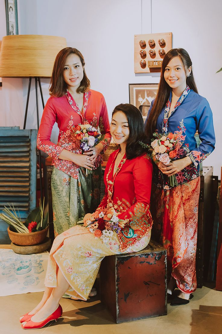 Sarong kebayas in bright red, porcelain blue and mint green fit for a boldly colored Peranakan wedding // Our Baba and Nyonya bridal shower styled shoot is as colourful and delightful as the sarong kebayas and desserts it showcases. Planned and styled by Moments at The Tranquerah in Kuala Lumpur, this blend of traditional Peranakan aesthetics and modern styling is sure to inspire you to embrace a history and culture that is uniquely South East Asian.
