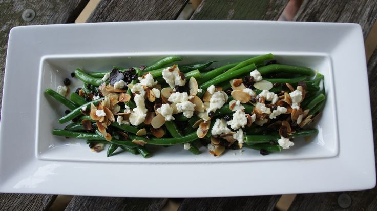 Healthy salad recipe: goats feta, currents, slithered almonds and beans.