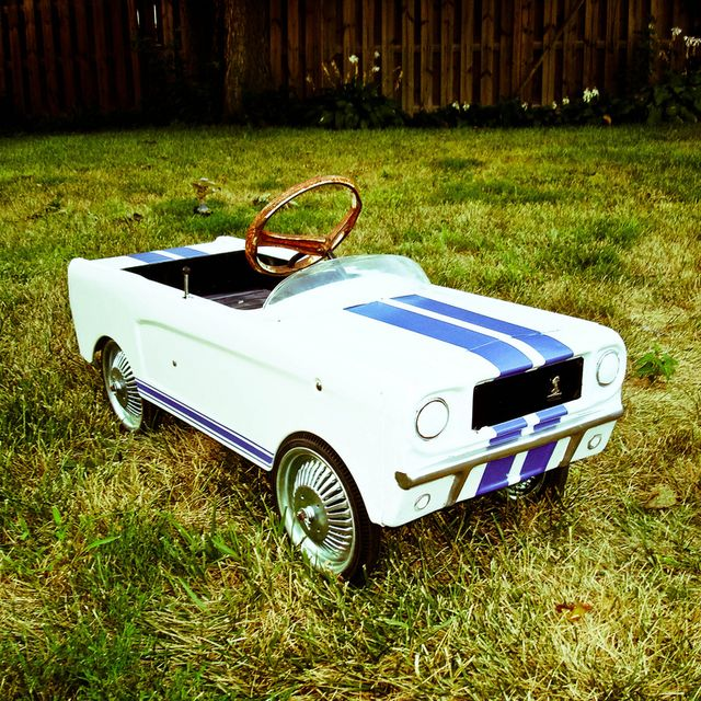 Mustang pedal car... Mine was turquoise...rusted... And my 5 older siblings played with it before me, but I loved that car.