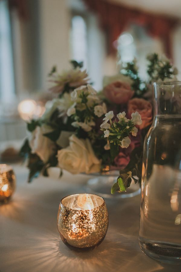Romantic table setting with mercury candle holder and colourful centrepiece #lakecomoweddingsandevents #lakecomo #flowers #table #setting © Gianluca & Mary Adovasio - http://www.gianlucaadovasio.it