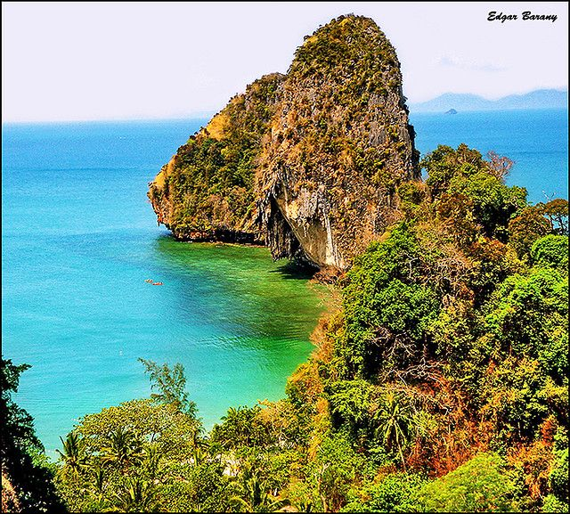 https://flic.kr/p/5kVxxi | Railay Bay / Thailand, Krabi | Railay Beach (Thai: อ่าวไร่เลย์) is a small peninsula located between the city of Krabi and Ao Nang. Accessible only by boat due to the high limestone cliffs cutting off mainland access. These cliffs attract rock climbers from all over the world, but the area is also popular due to its beautiful beaches and quiet relaxing atmosphere. Accommodation ranges from inexpensive bungalows popular with backpackers and climbers, to the renowned…