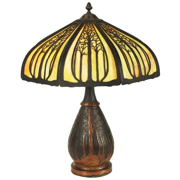 "Arts & Crafts lamp, slag glass shade with metal overlay on a bronze base with tree motif, two professionally replaced glass panels, 20""dia x 25""h, very good condition"