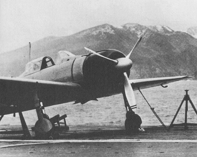 Japanese A6M2 zero fighter on the deck of an aircraft carrier Akagi in Hitokappu Bay (island of Iturup, Kuril Islands). The picture was taken in January 1941 before the Japanese attack carrier connections into the sea to attack the American base of Pearl Harbor.