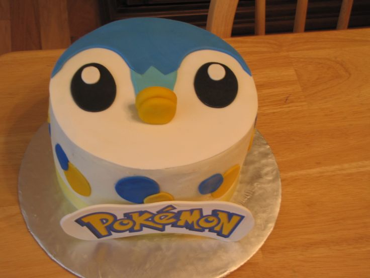Piplup cake , iced in buttercream with fondant decorations - the POKEMON is printed then placed on gumpaste.