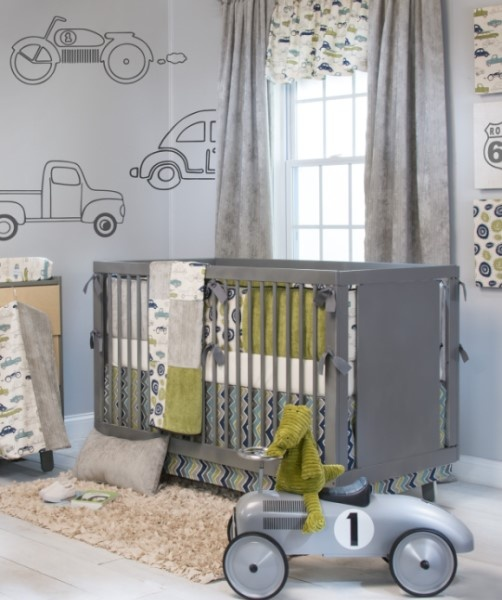 The Uptown Traffic baby boy's crib bedding collection combines modern circle and zig zag patterns with a vintage transportation print and soft velvety solids. It features a unique color palette with shades of green, blue and grey.