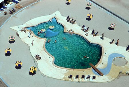 Title:Cat-Shaped Pool   Caption:A swimming pool in the shape of a cat at the Fontainebleau Hotel, Miami, circa 1955.       Artist:Slim Aarons  Date:Circa: 1955