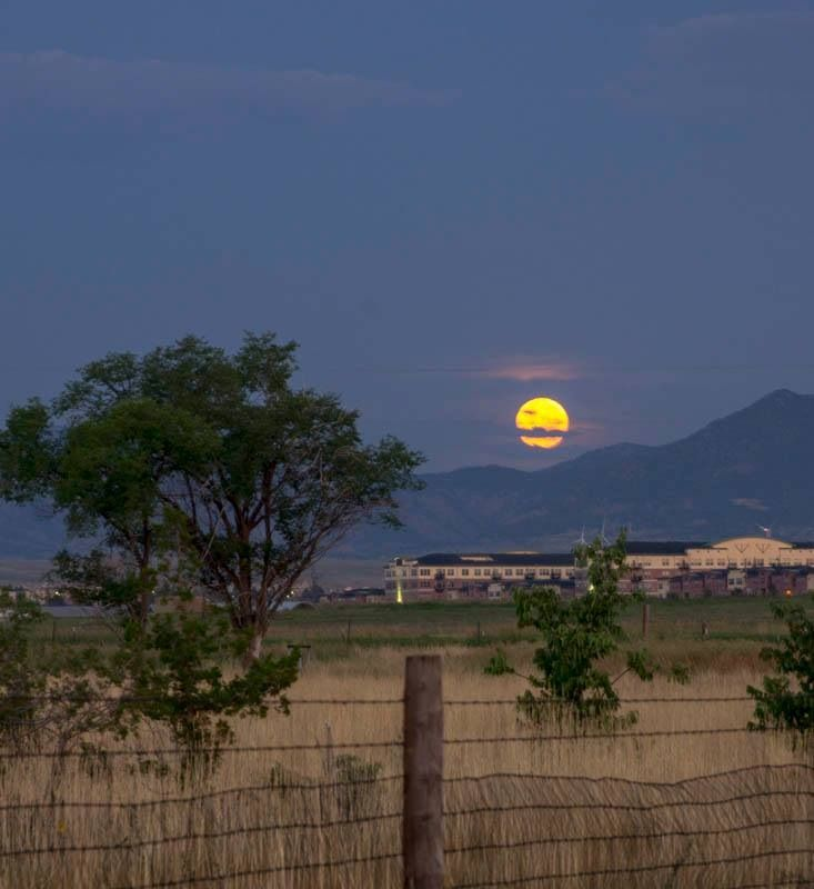 This photo of the moon over broomfield colorado is breathtaking