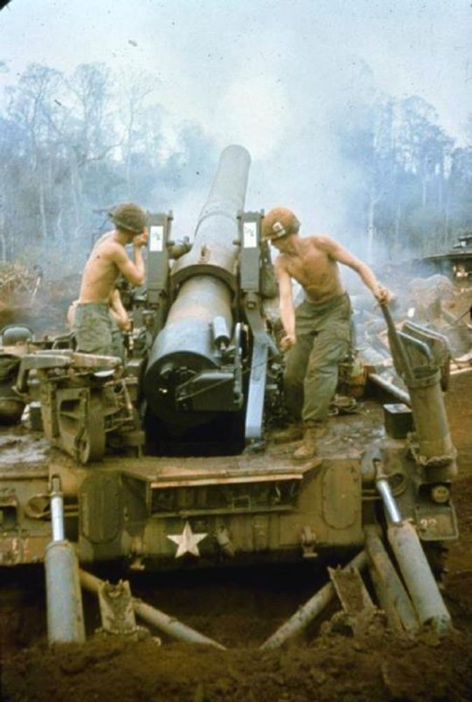 Gunners of B Battery 6th Battalion 27th Artillery Regiment fire a M-110 howitzer during a fire support mission at Landing Zone Hong, approx. 12 km N.E. of Song Be, March 26 1970.