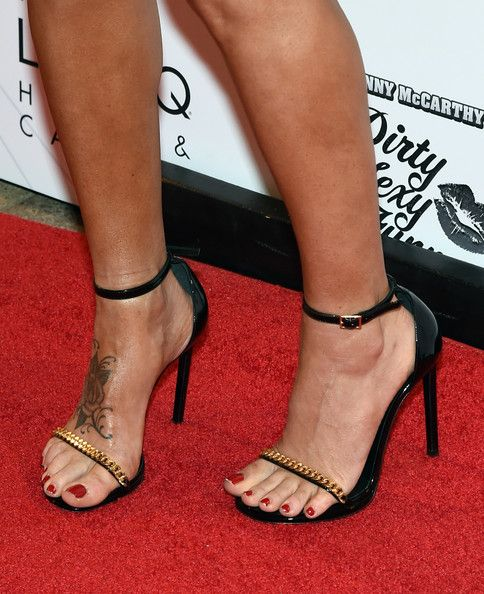 "Jenny McCarthy Photos - Actress/comedian Jenny McCarthy (shoes, tattoo details) arrives at The LINQ to promote her ""Dirty Sexy Funny"" comedy show on September 25, 2014 in Las Vegas, Nevada. The tour will kick off on September 26 at The Quad Resort & Casino in Las Vegas. - Jenny McCarthy's Comedy Show"