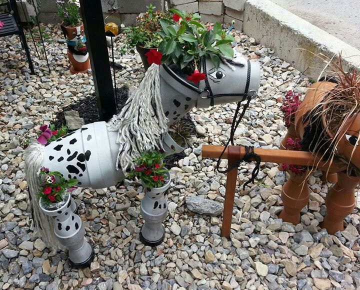 Painted and finally finished flower pot horse made from terra cotta pots