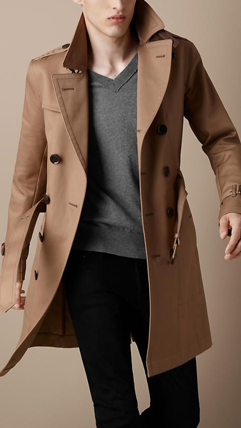 Trench coats for men are still seen in fairly neutral colors. Most, but not all are double breasted and only some include a belt. Some are still made out of heavy material, but some can be found in a light weight material and can be used more like a rain coat. 4/6/15