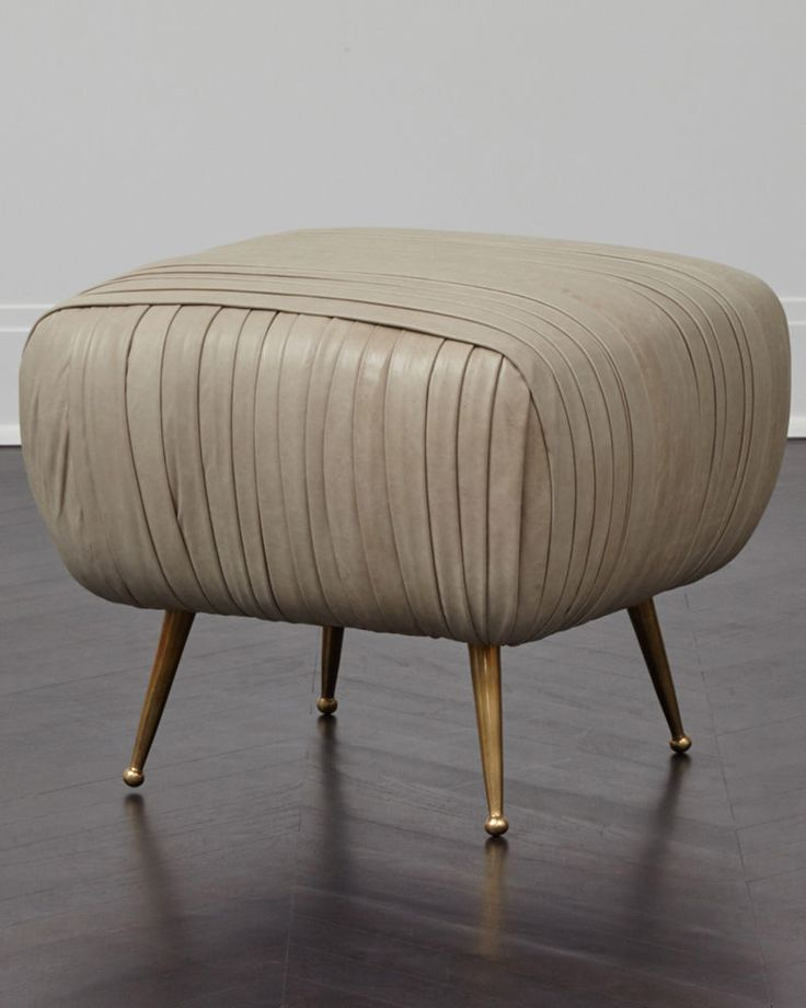 KELLY WEARSTLER | LEATHER SOUFFLE OTTOMAN. Ruched leather detail on tapered legs of solid cast bronze.