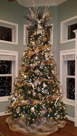Christmas Tree with burlap garland in white, gold, silver, and brown.