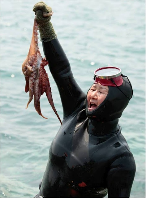 """Jeju Island, South Korea.  One of the Haenyo - the Diving Grandmas of Jeju.  A loophole that women do not have to pay taxes on conch, abalone, and octopi got a slew of women really good at diving.  And don't miss """"Loveland"""", a theme park designed to inspire newlyweds.  The erotic statues capture a different sort of diving."""