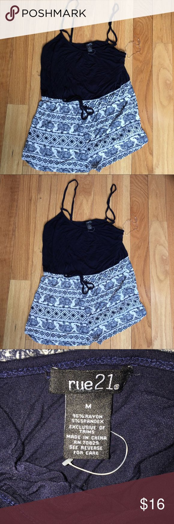 NWOT Rue 21 navy blue romper medium Navy blue animal print romper; new without tag; cute set! Size medium Rue 21 Shorts