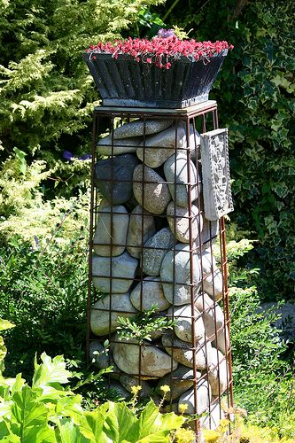 SBG totally loves gabion structures - make with wire fence or mesh and gathered stones.  Latest thing!