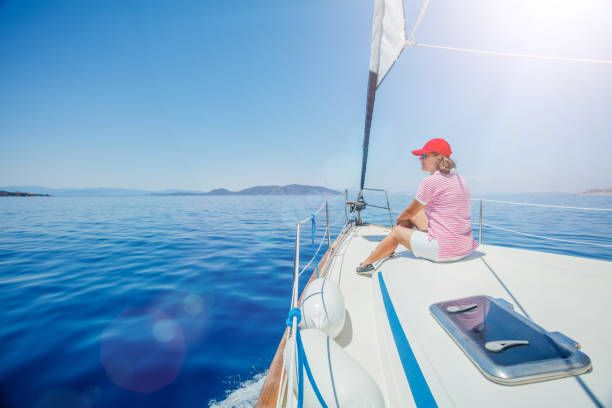 Woman Relaxing On Yacht In Greece Stock Photo