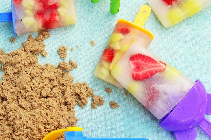 Coconut Icy Poles.  So easy, just cut fruit of your choice (we used strawberries and grapes), place into the container and then pour coconut water on top and freeze for 2 hours.