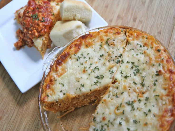 Baked spaghetti pie to the dinner rescue! Creamy, four cheese baked spaghetti topped with a homemade spaghetti meat sauce. So easy to make and leftovers are just as good, if not
