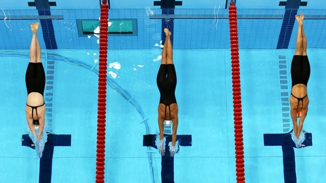 A robotic camera captured this image of Missy Franklin of the United States, Federica Pellegrini of Italy and Melania Costa Schmid of Spain diving in the pool for the second semi-final heat of women's 200m Freestyle on Day 3 of the London 2012 Olympic Games at the Aquatics Centre.