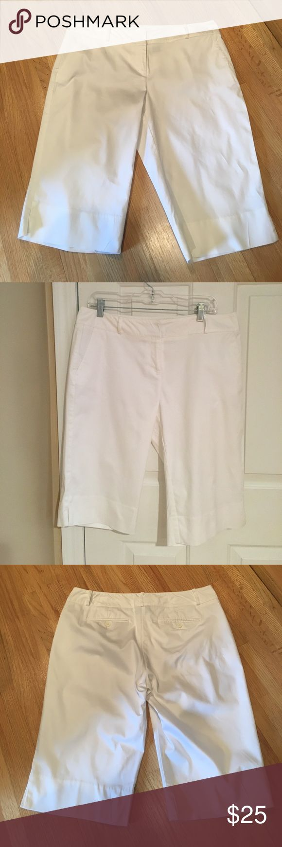 """White Bermuda Shorts INC size 12 White Bermuda Shorts from INC in a size 12. There are two open pockets on the side. Two pockets in the back. Fabric listed in photos. These shorts have a zipper fly with two claps at the top. There are two small slits on the outside of each pant leg (see pictures details). Machine washable.  Length-24"""" Rise- 10"""" Inseam-14"""" Waist-17"""" INC International Concepts Shorts Bermudas"""