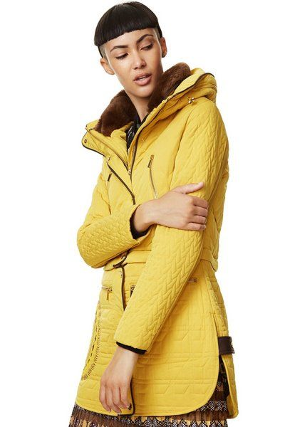 Desigual CALIFORNIA coat in mellow yellow. These coats are hard to find in yellow (it also comes in black) and we only have a few left. The coat unzips halfway down, transforming into a bomber jacket. Now on sale at 20% off during our Mid Season sale. Angel has Desigual for women, men & kids, Go to angelvancouver.com