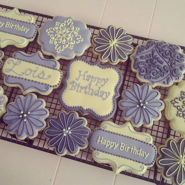 Purple themed birthday cookies using flower, rectangle plaque and square plaque cookie cutters.