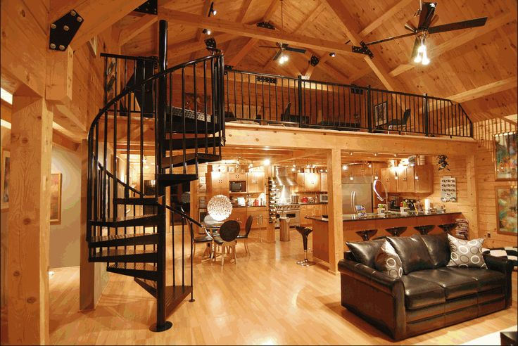 modern log home interior spiral staircase to loft