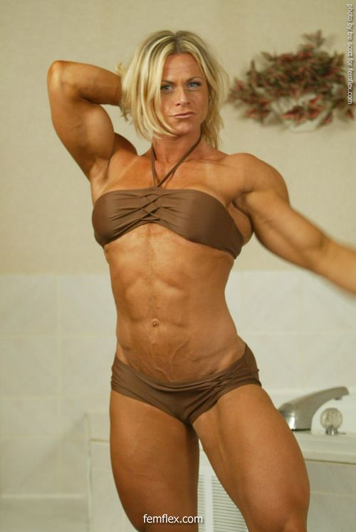 image Sexy blonde female bodybuilder in see through top works out