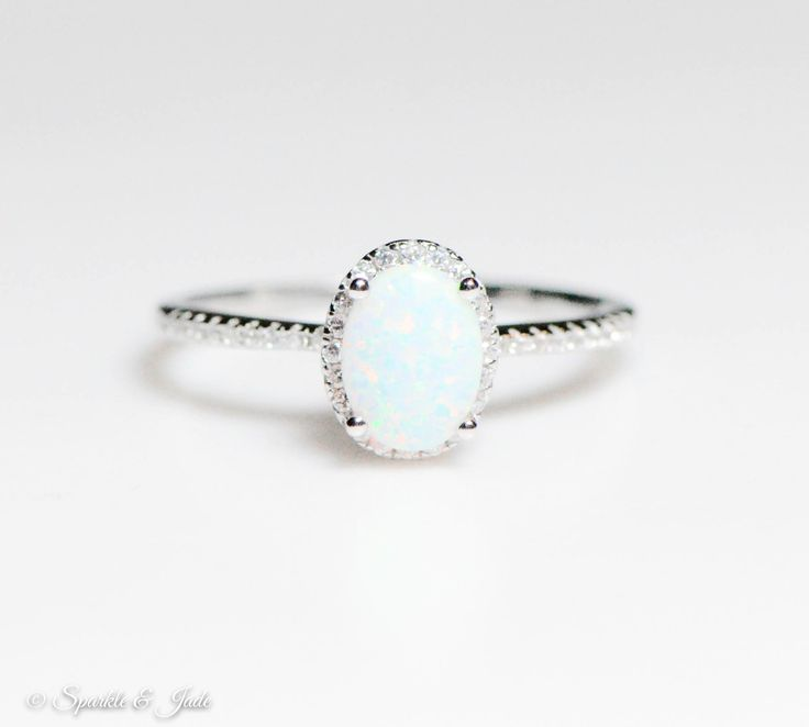 Crafted of solid .925 Sterling Silver 1mm wide band 7.10mm overall height 8x6mm Oval Lab-Created White Opal White Cubic Zirconia