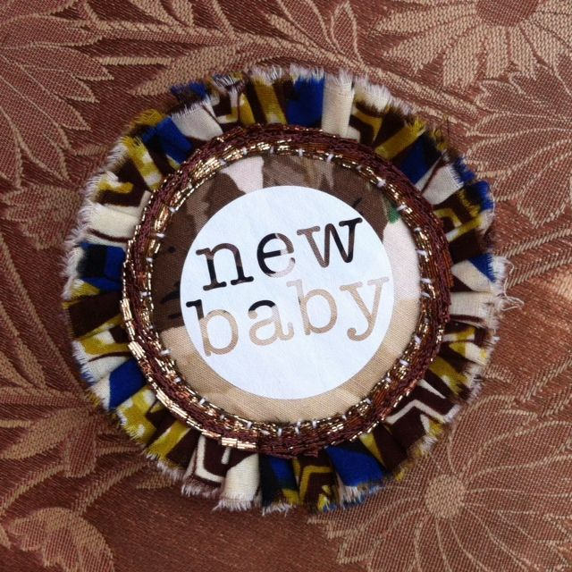 EARTHY coloured NEW BABY rosette pin badge.