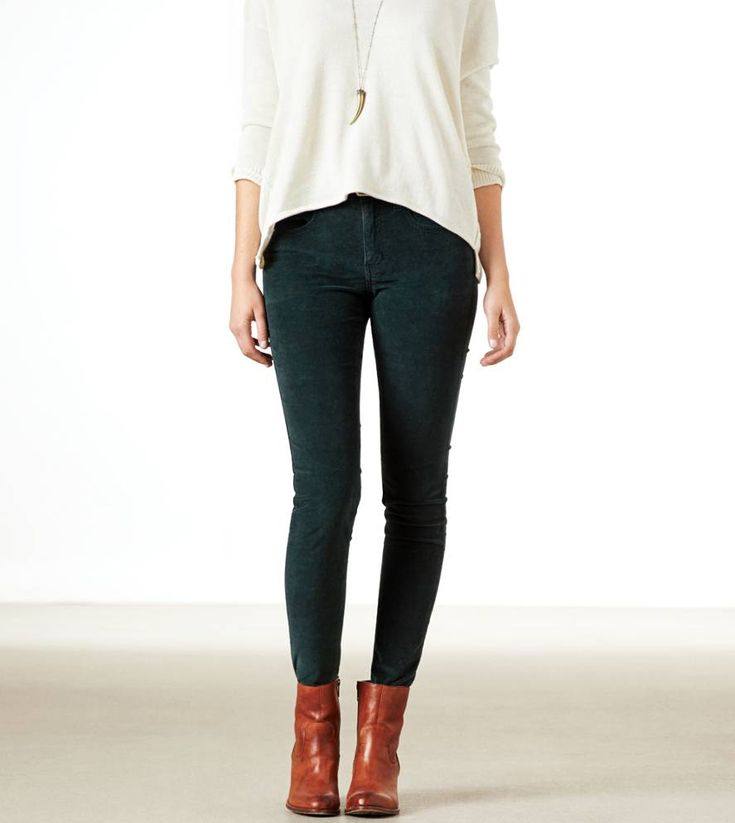 Cream shirt. Forest green/colored pants. Brown booties. Work business casual. Simple long necklace.