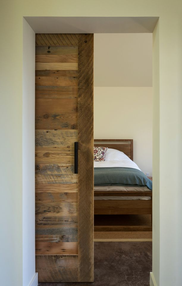 Sliding barn door into the bedroom. For guest bedroom? I love the look of the door even as a swing-out!