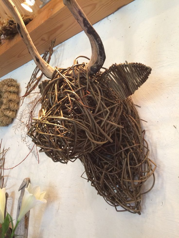 Bull made out of willow and a branch for horns