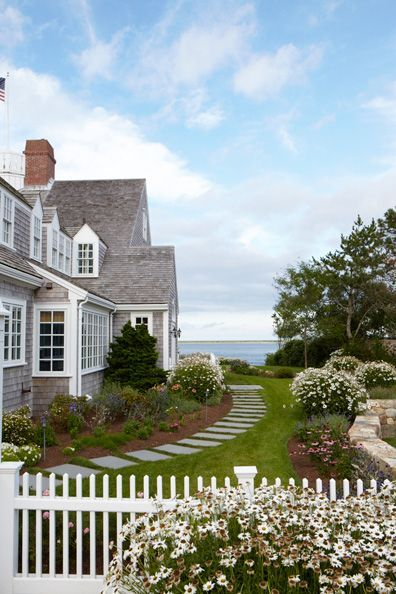 nantucket beach home with stone pathway through the lawn to the beach